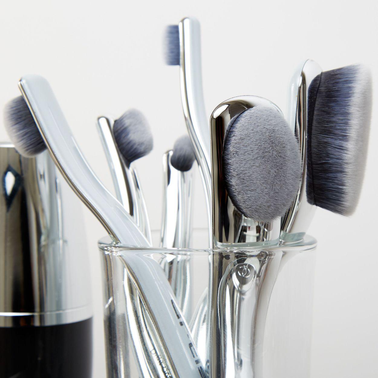 Digit brushes in cup on vanity