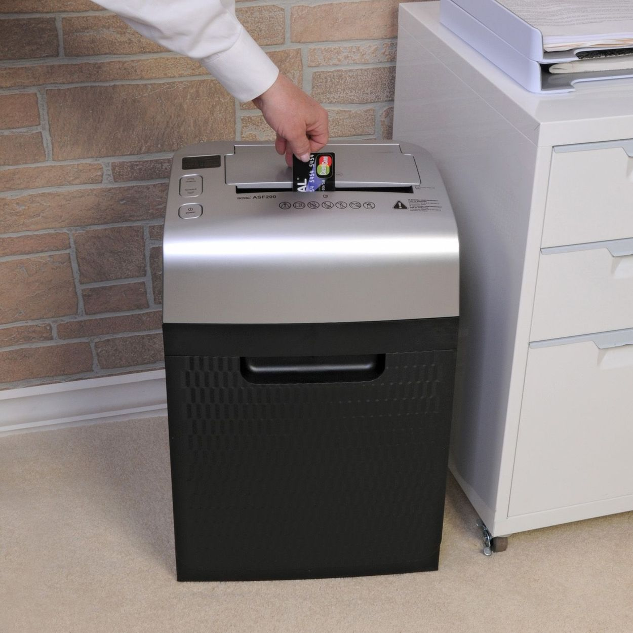 Lifestyle image of unit with credit card in entry slot